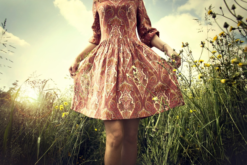 carefree woman walking in the meadow