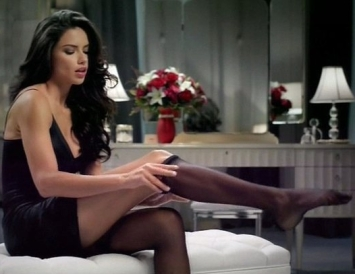 adriana-lima-was-seen-getting-ready-for-a-hot-date-as-she-slipped-on-some-suspenders-in-her-first-super-bowl-commercial-for-teleflora